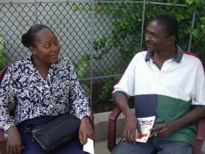 Frantzie and Heguel are shown sitting here. The picture was taken at the fourth annual Open Space Meeting on Open Space, at the Villa Ormiso in Bizoton, Haiti.