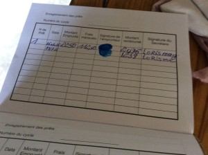A record of Atelia's loan and her first repayment in a separate section of her savings booklet.
